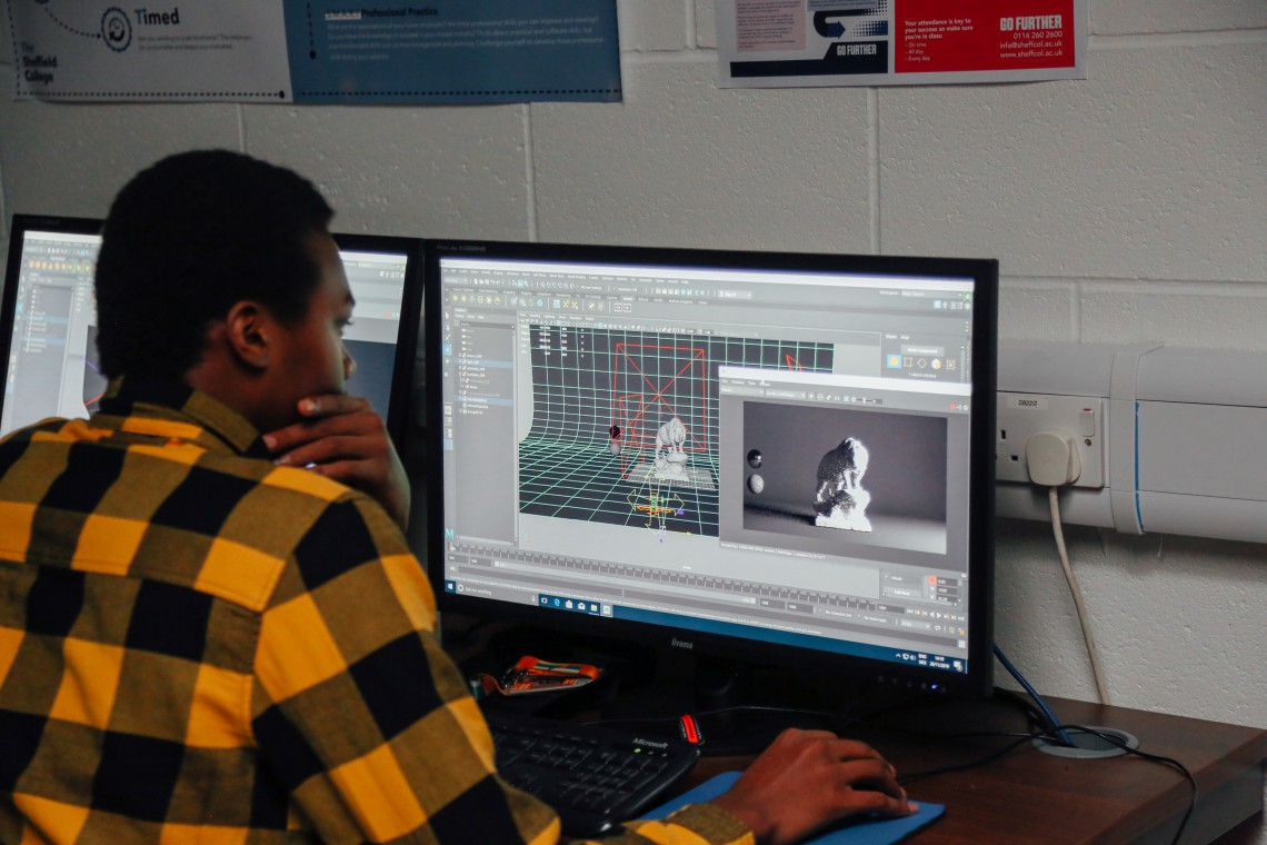 Games design student works on creating 3D lighting effects in a masterclass